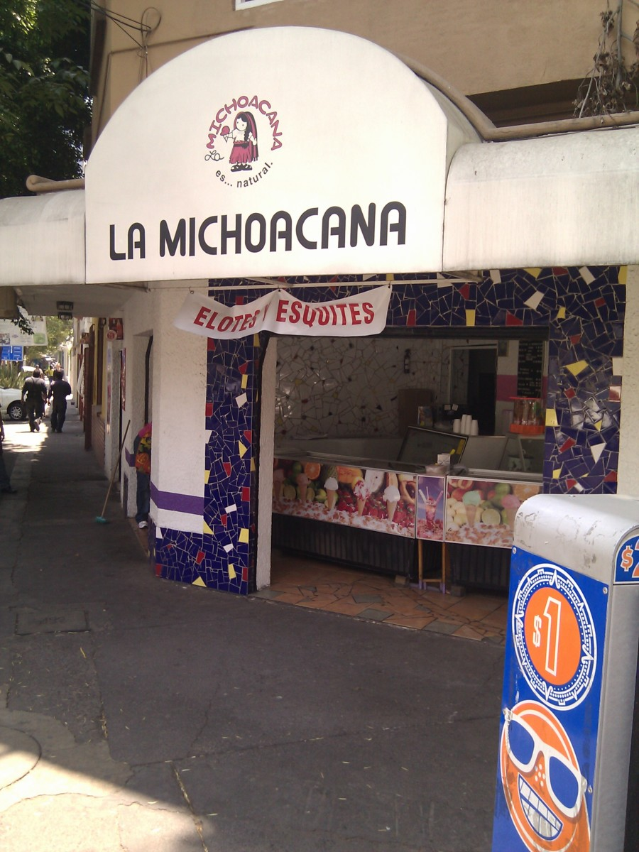 "La Michoacana (""the woman from Michoacan""), a popular ice cream shop chain in Mexico. The sign says they also sell elote (corn on the cob) and esquites (corn kernels with mayonnaise, chile and epazote)."