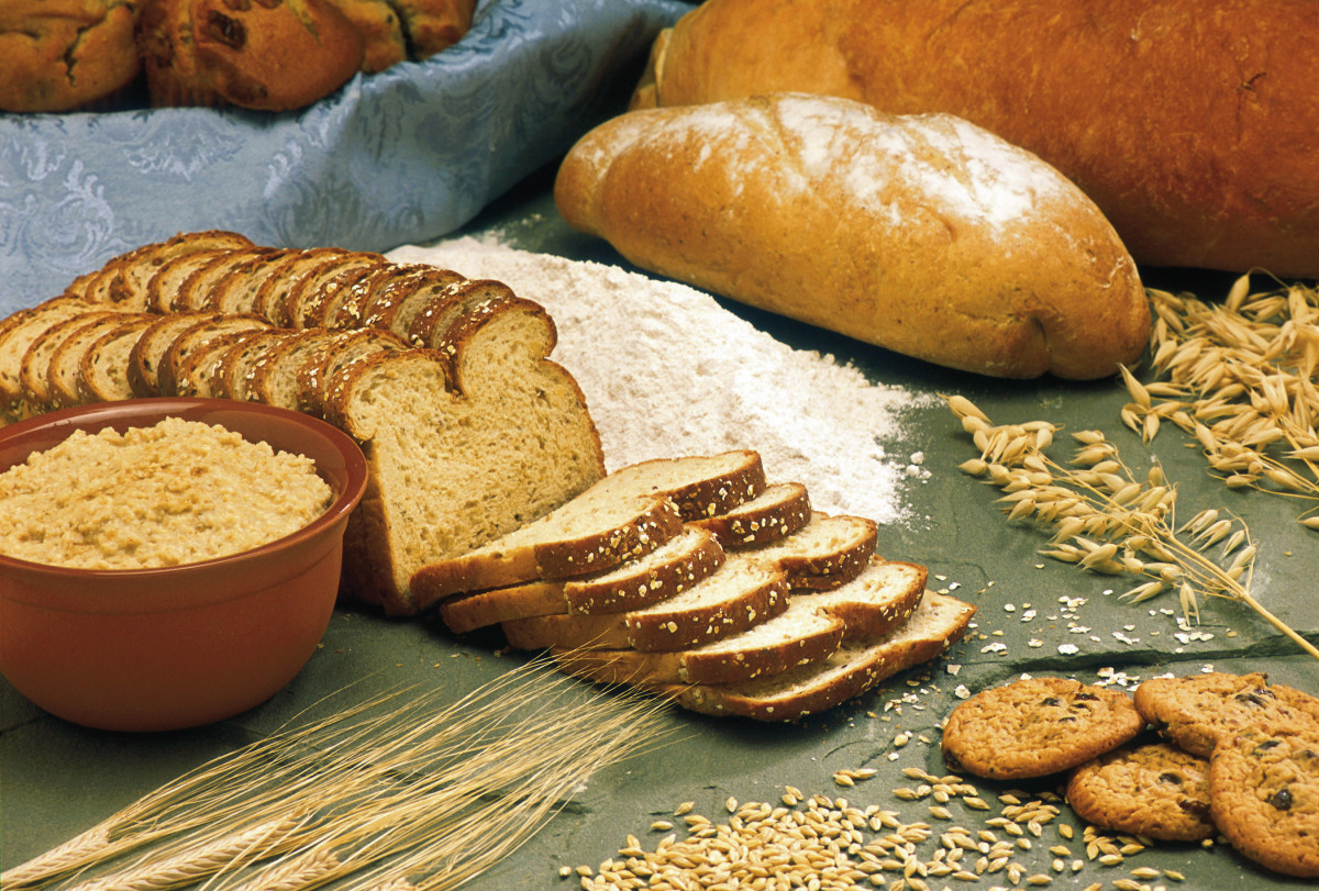 Barley (lower left), and oats (upper right), and bread and cookies made from the grains.