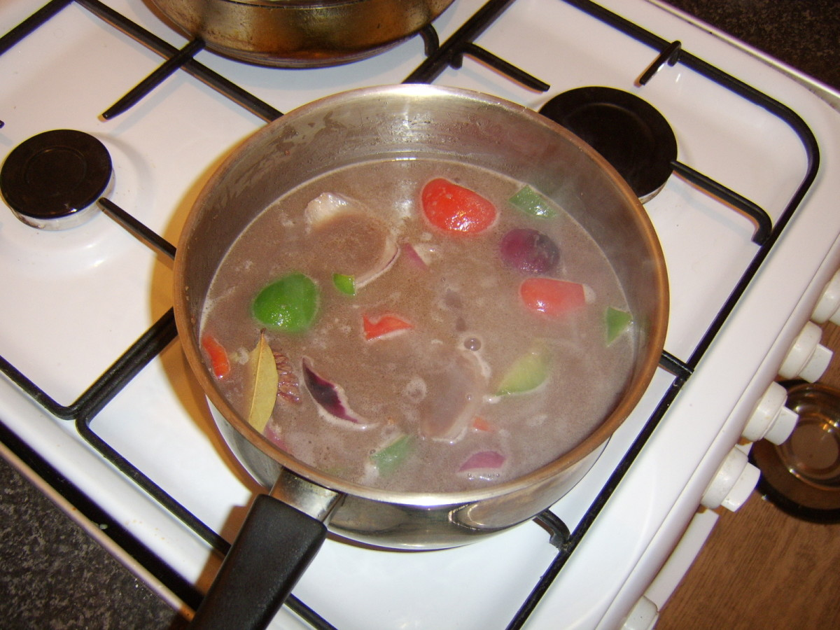 Bring the beef stock and red wine to a simmer