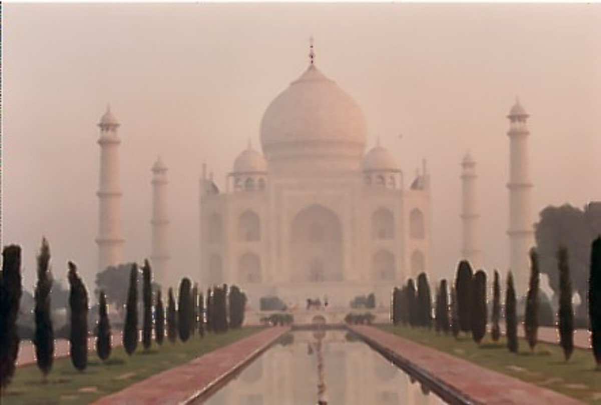 The taj Mahal through the early morning mist.