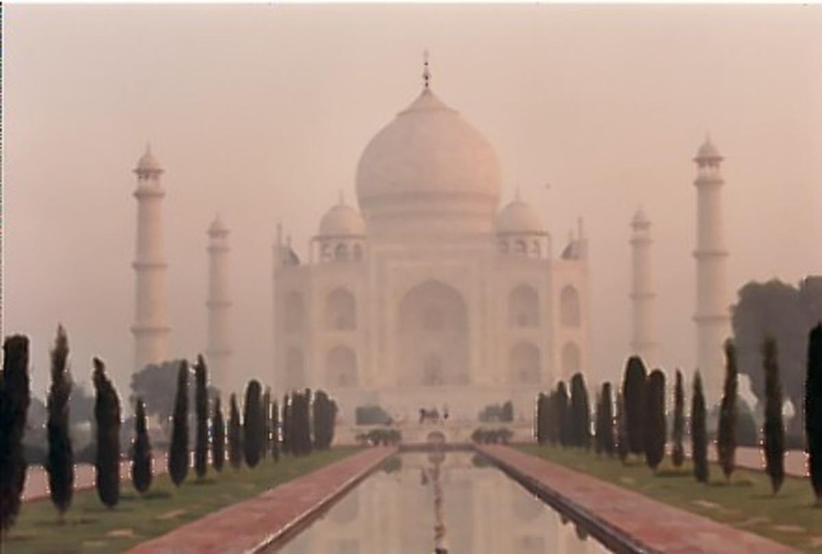The taj Mahal through the early morning mist.