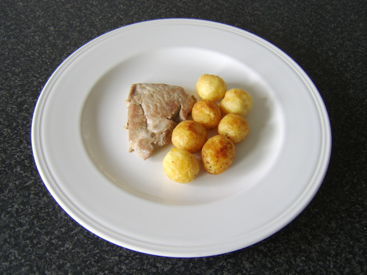Plate the pork and the roast potatoes