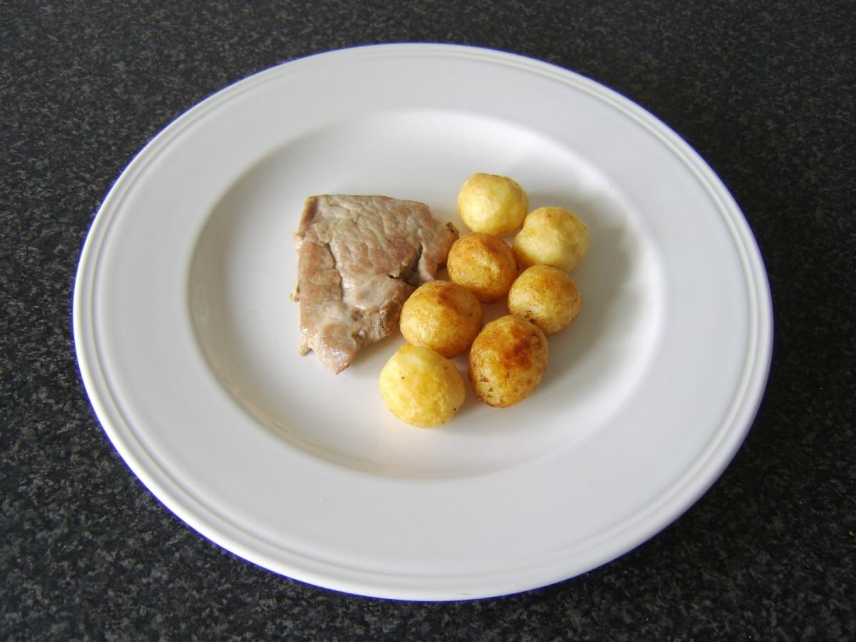Plate the pork and the roast potatoes