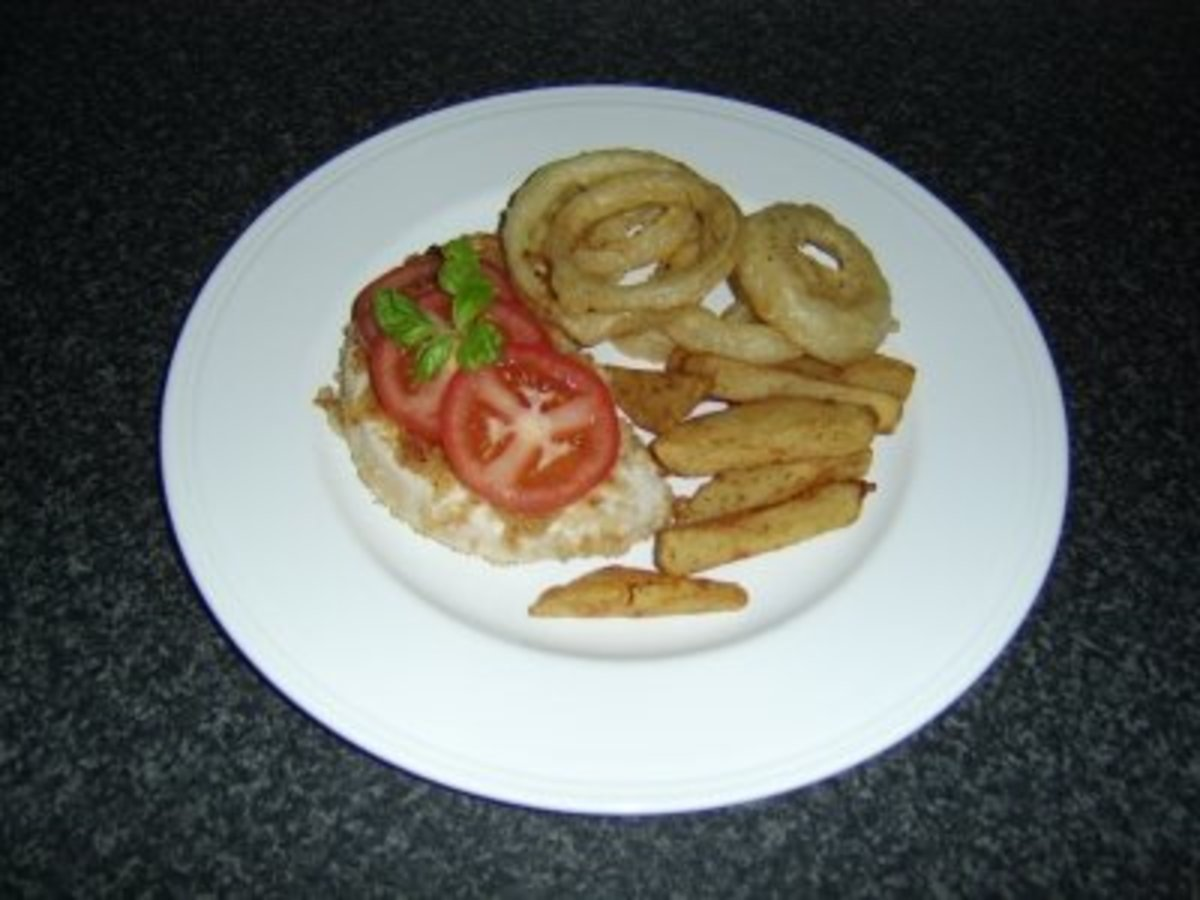 """Here's one plating that I enjoy when I make these tasty, fried onions. I call this """"homemade onion rings with turkey schnitzel and chips."""""""
