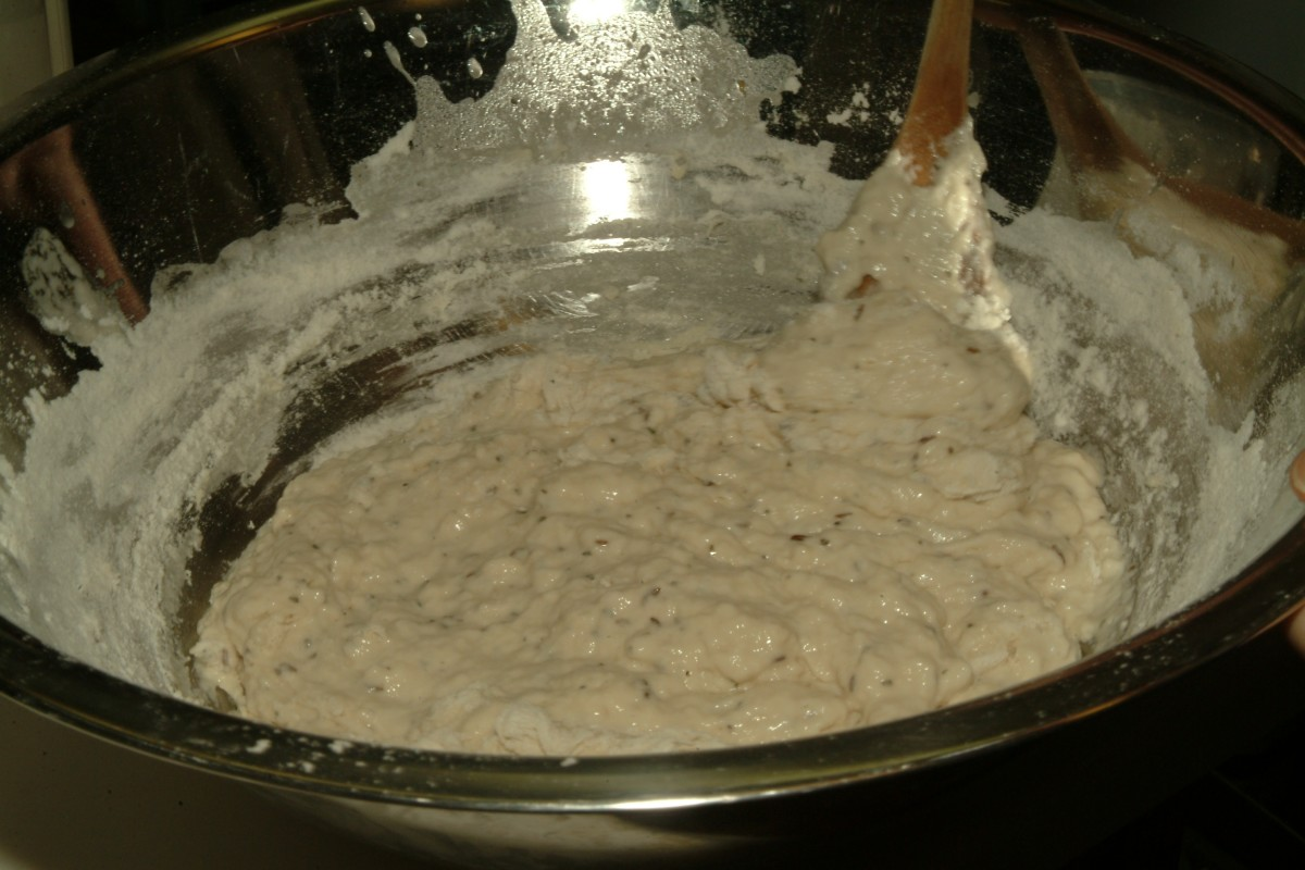 Continue adding flour until batter starts to form.