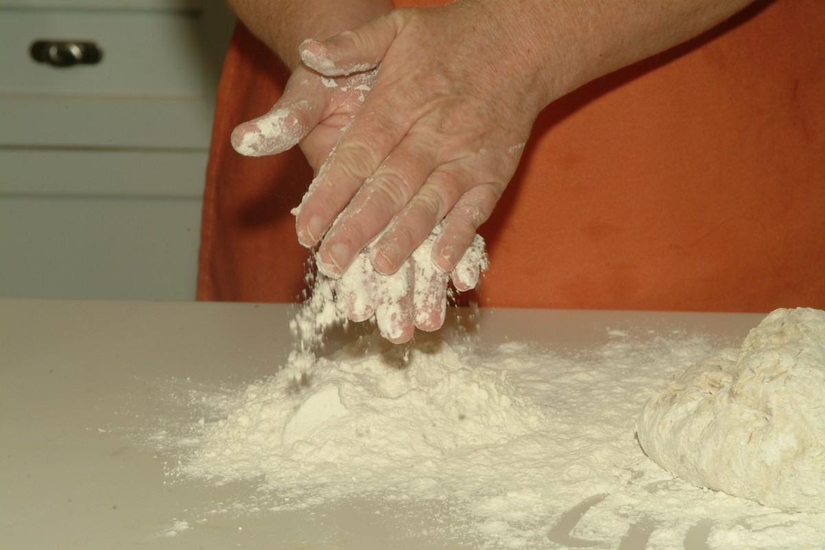 Flour your clean hands before kneading the wet dough so it won't stick.