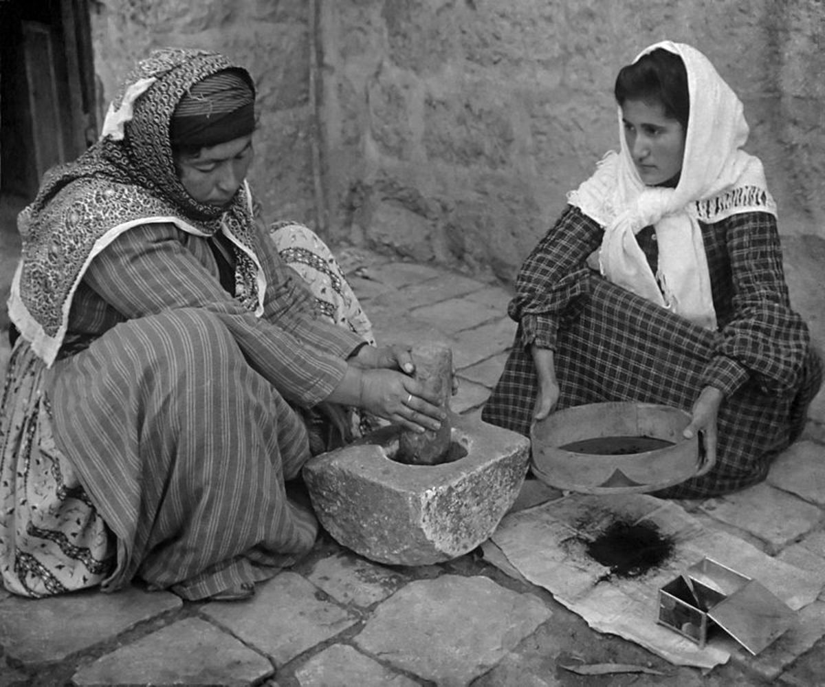Palestinian women grinding up coffee manually in 1905.  Coffee was first consumed in Ethiopia but it was the Arabs of Yemen who were the first to cultivate it as a crop and create the drinking and coffee house culture that we recognize today.