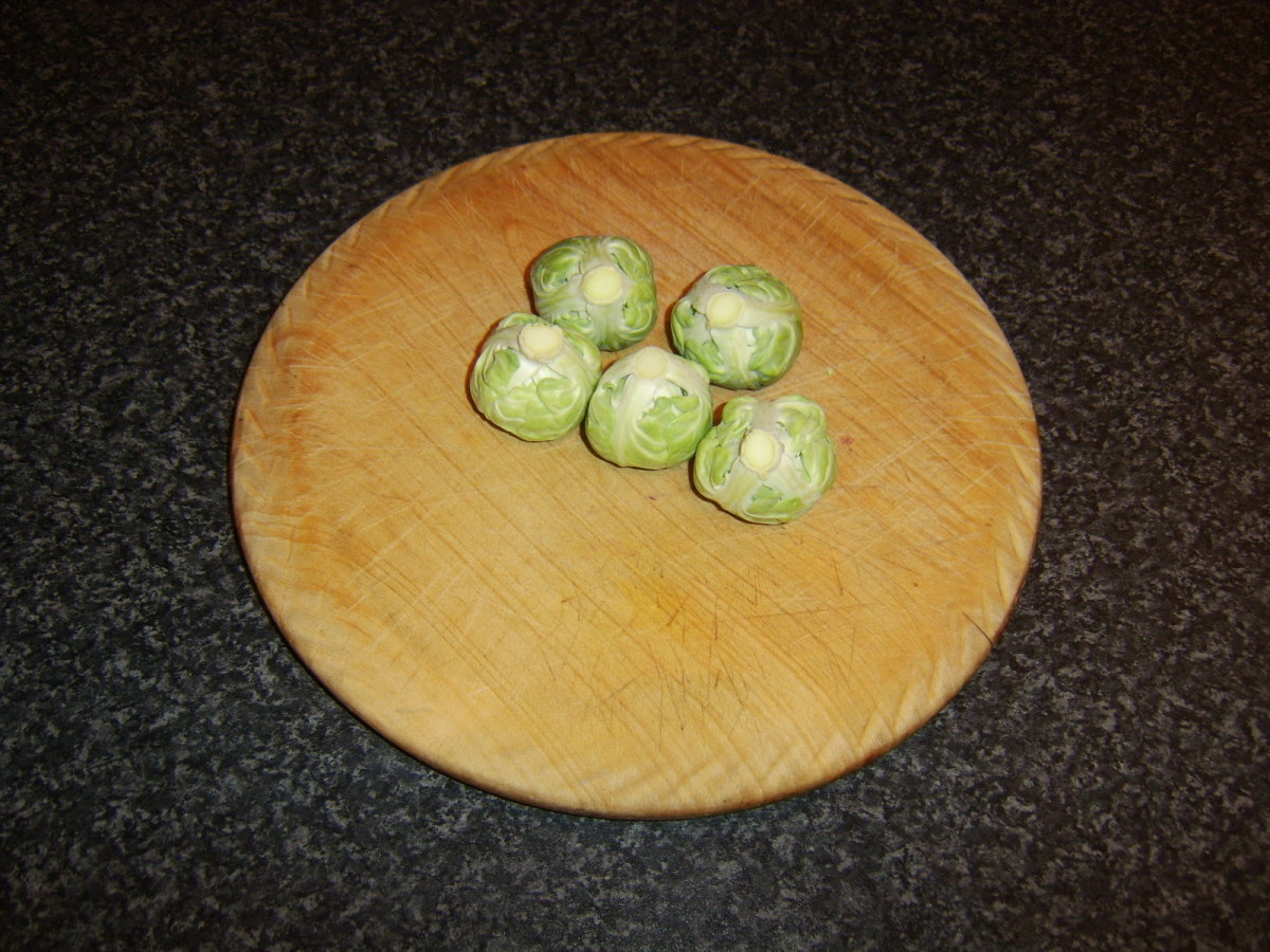 Brussels sprouts are prepared for the pot.