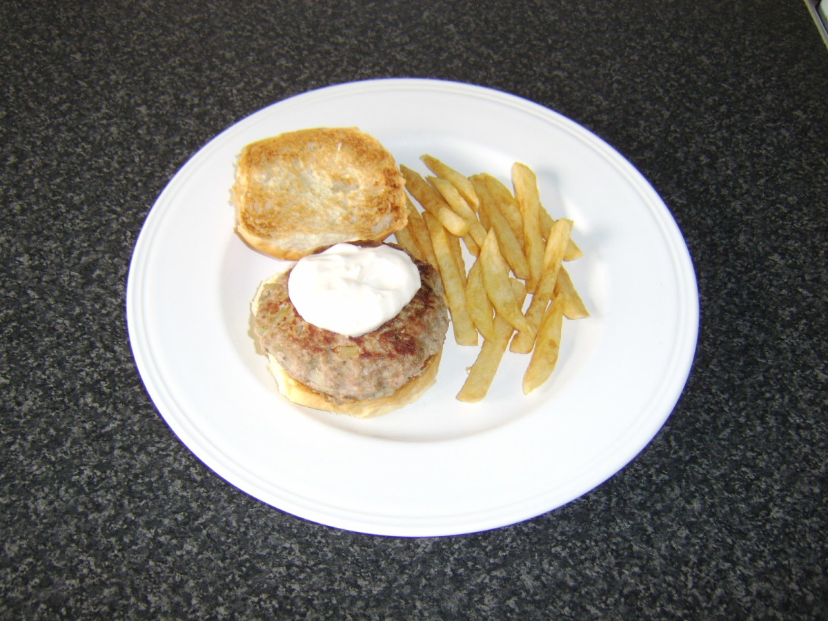 This half pound sage and onion turkey burger is served on a toasted bread roll with garlic mayo and a side of fries