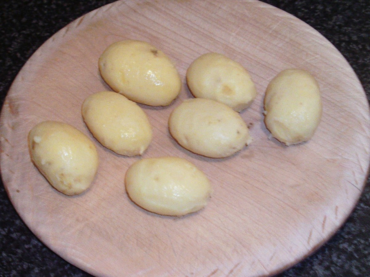 Cooled and peeled potatoes ready for deep frying