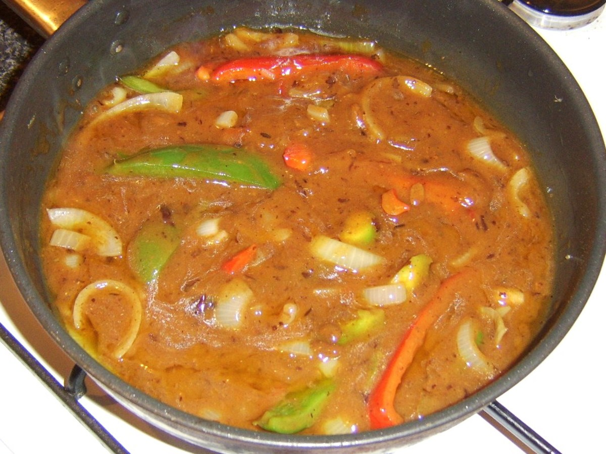 Vegetables and black bean sauce are brought to a simmer