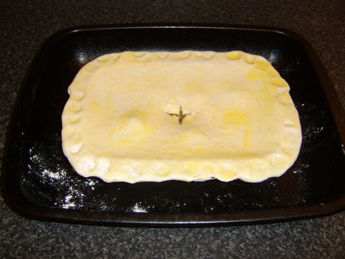 The lamb and turnip pie is glazed and ready for the oven