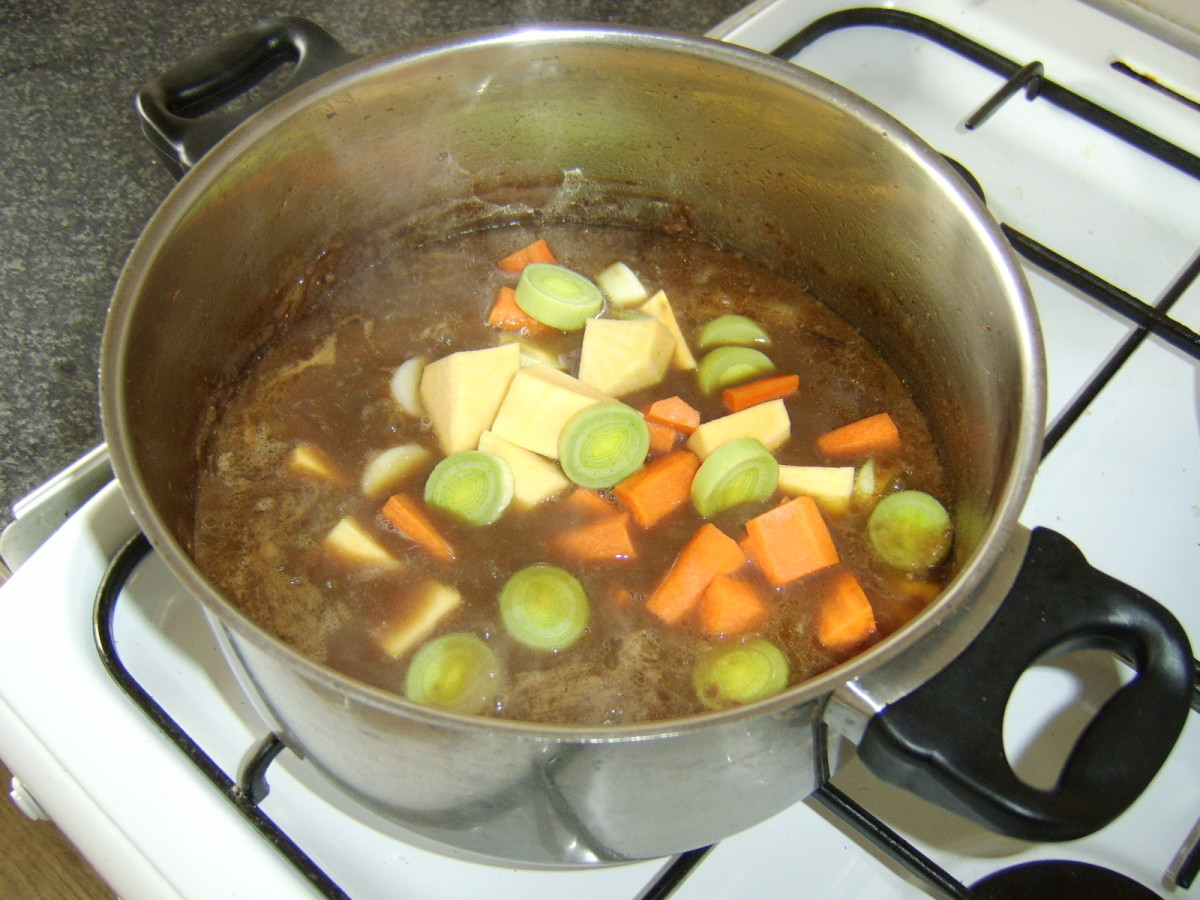 The vegetables are added to the reduced stock and venison
