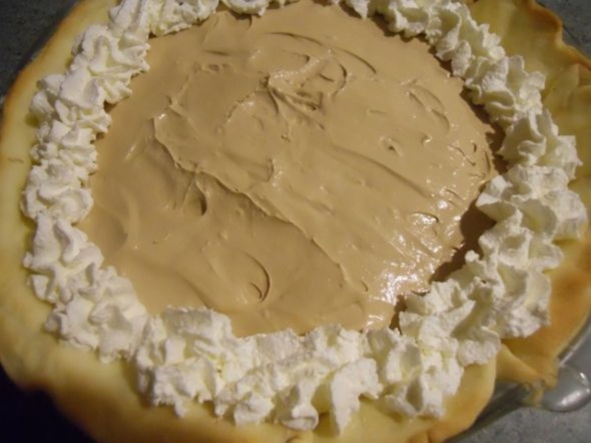 Put little puffs of whipped cream around the edges.