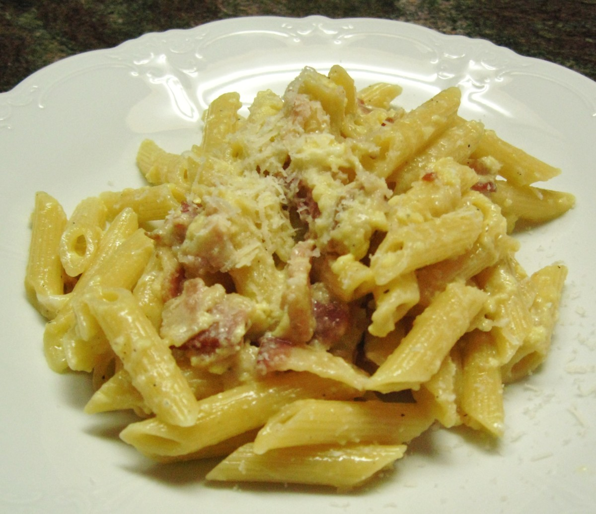 Penne Carbonara, pasta with eggs, bacon, and Parmesan cheese.