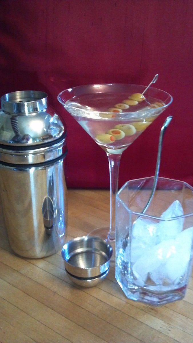 Martini with olives, rocks on the side