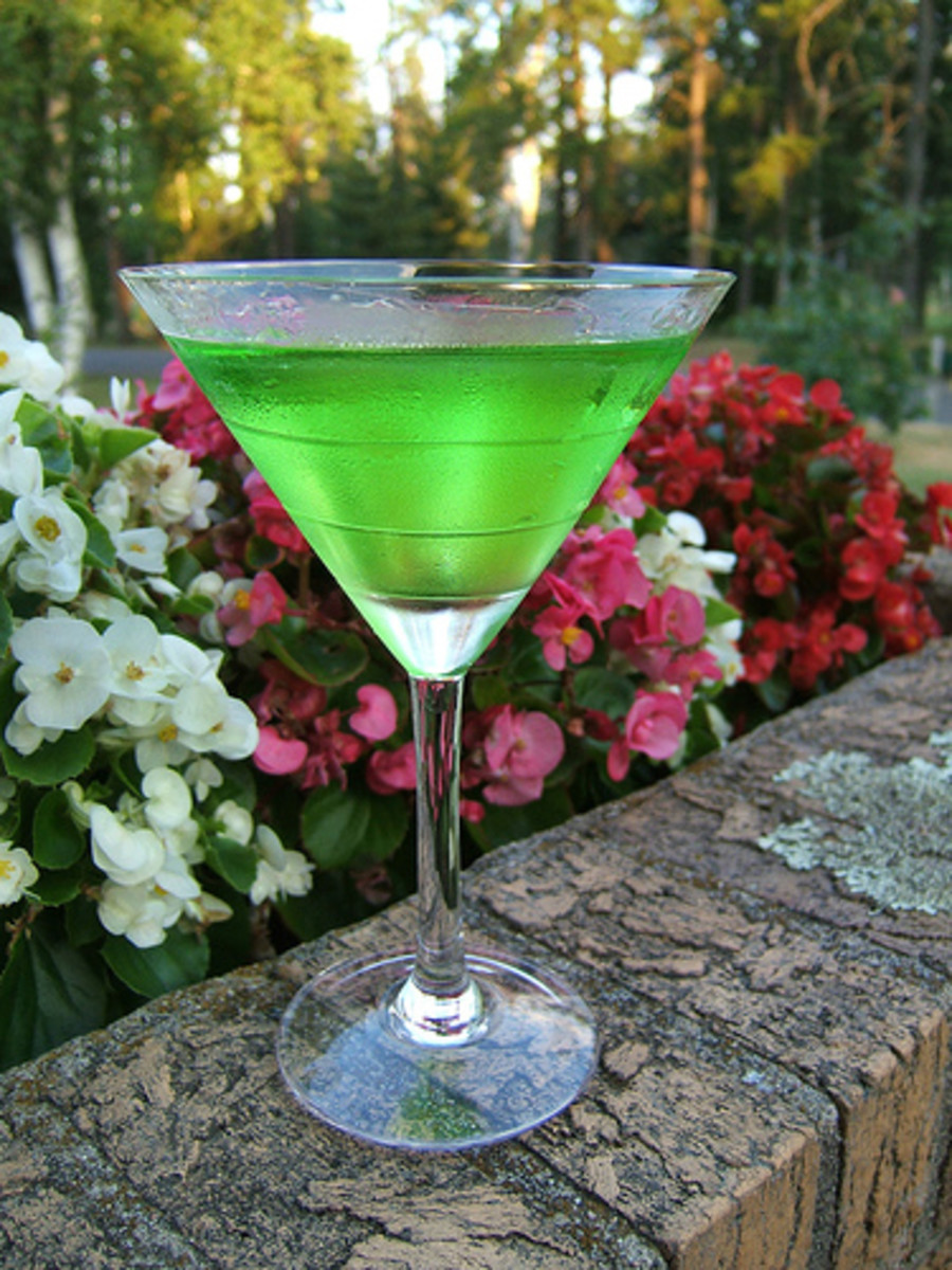 An apple martini is full of taste and color.