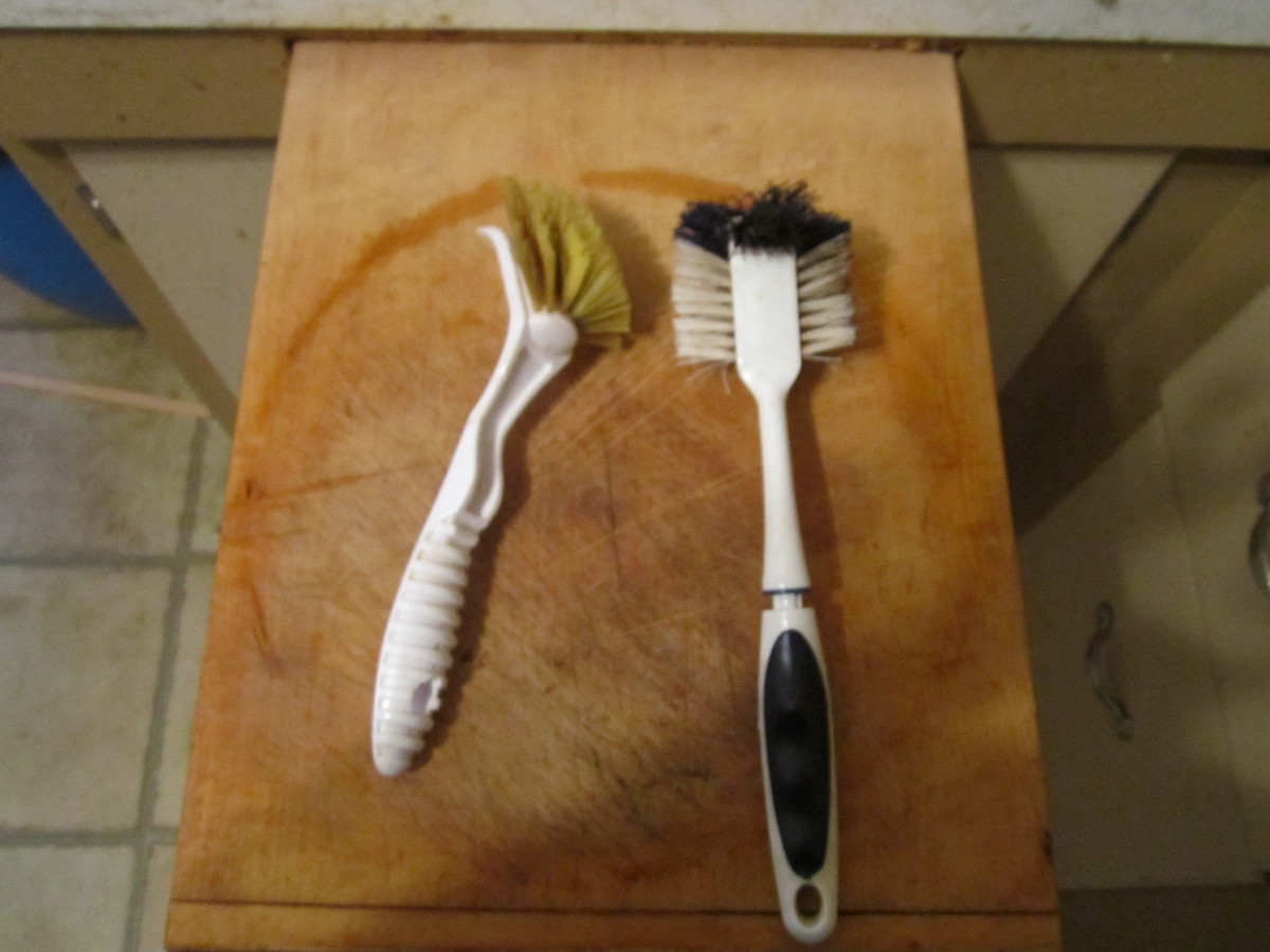 These are soft scrubbing brushes used to clean the pans after use with the help of hot water. No soap required!