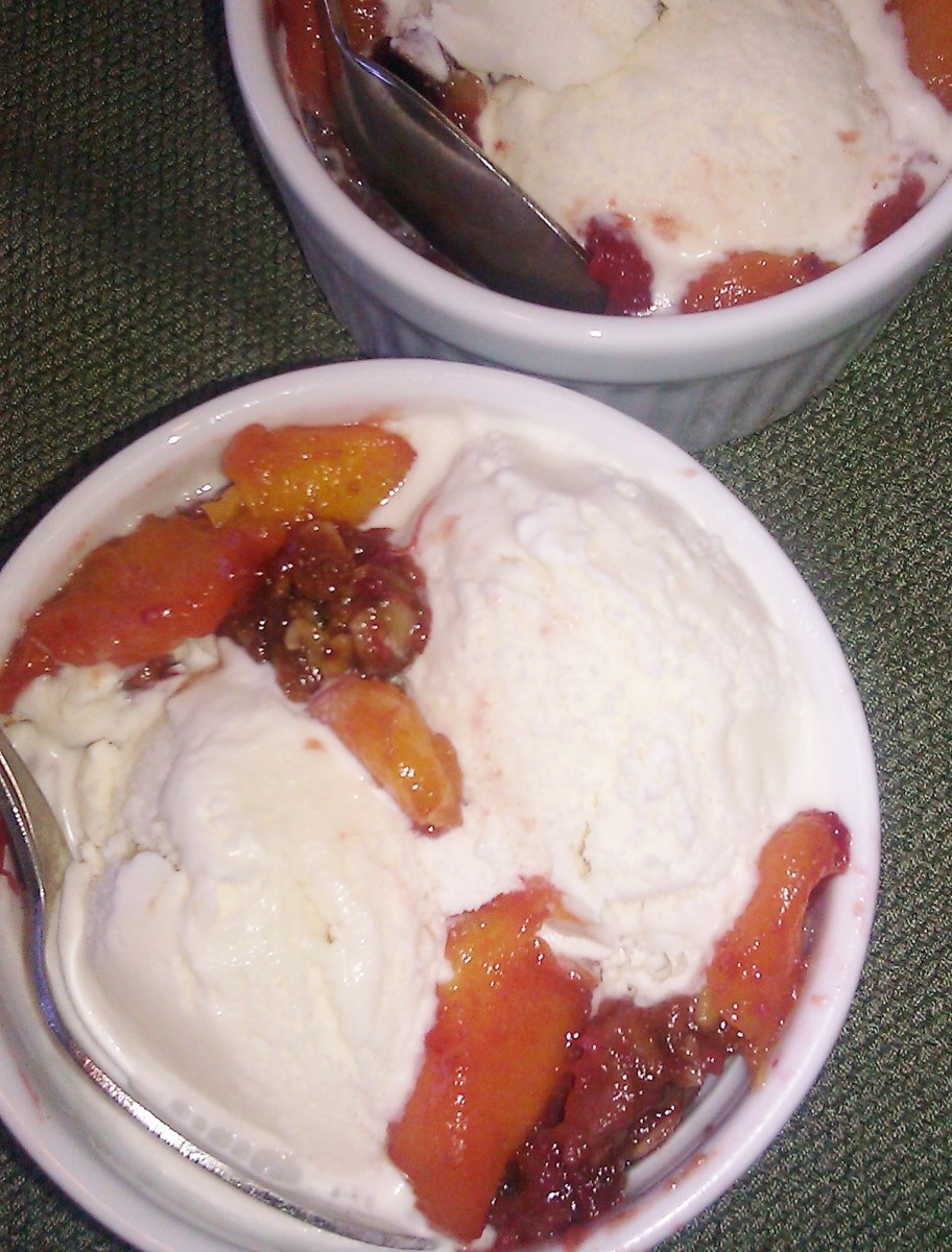 Make your favorite ice cream whenever you want! This one's vanilla, served over warm peach berry crisp.