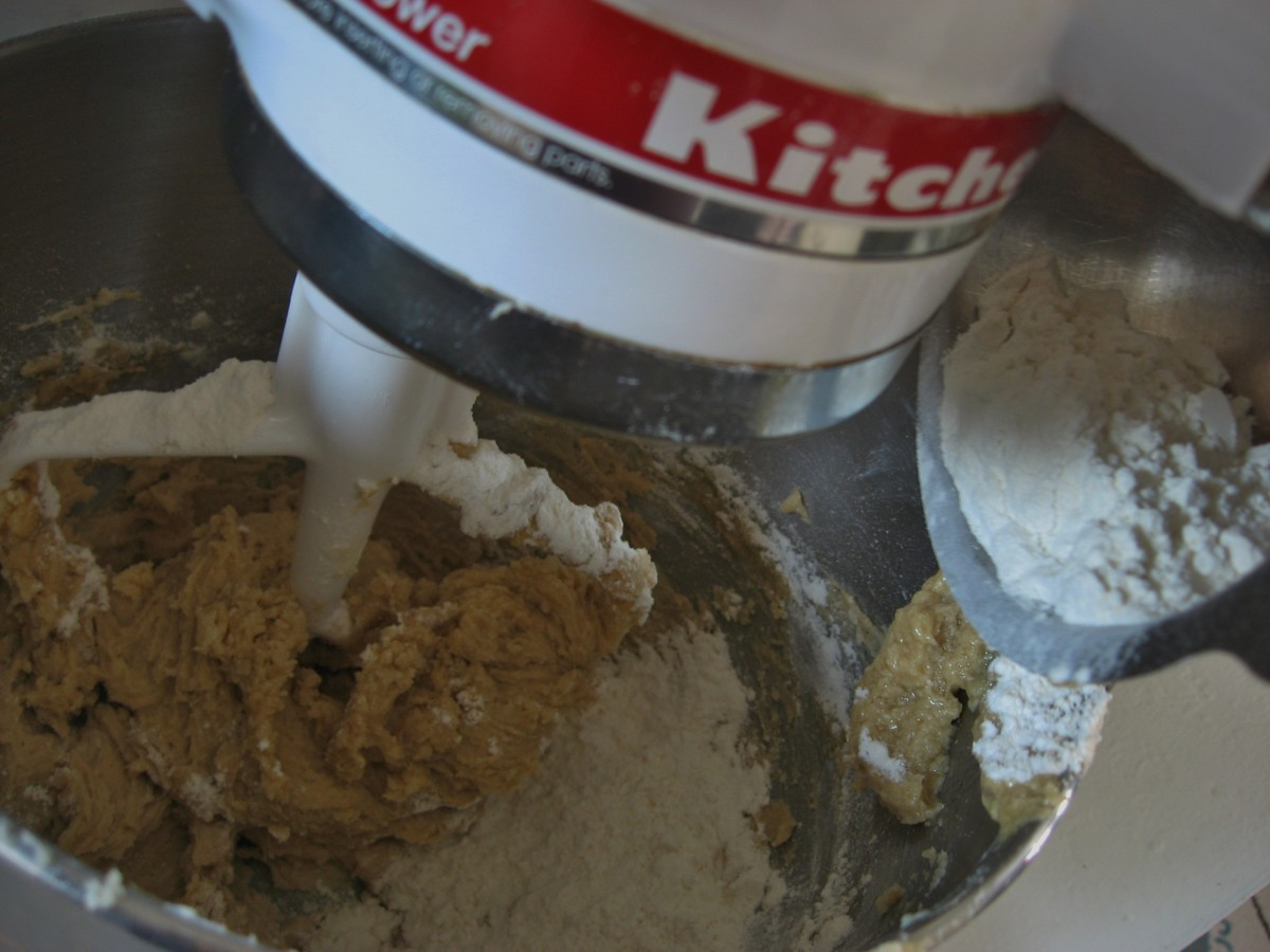 Gradually add the flour mixture slowly while stirring at low speed.  Scrape after adding the flour mixture.