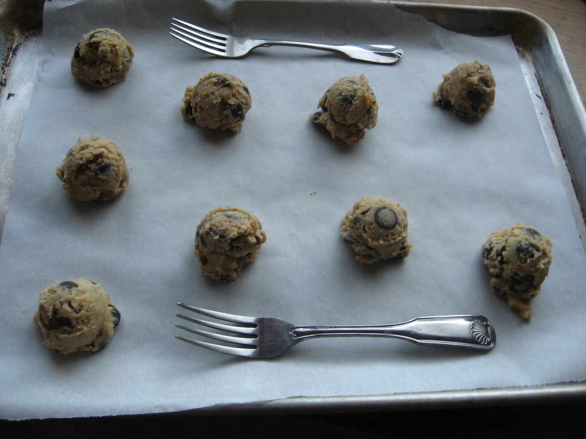 Use a parchment paper on sheetpan and place same size scooped cookie dough leaving spaces in between.