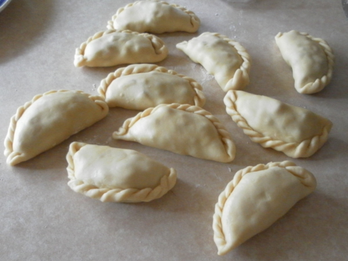 Wrapped curry puff pastries ready for frying.
