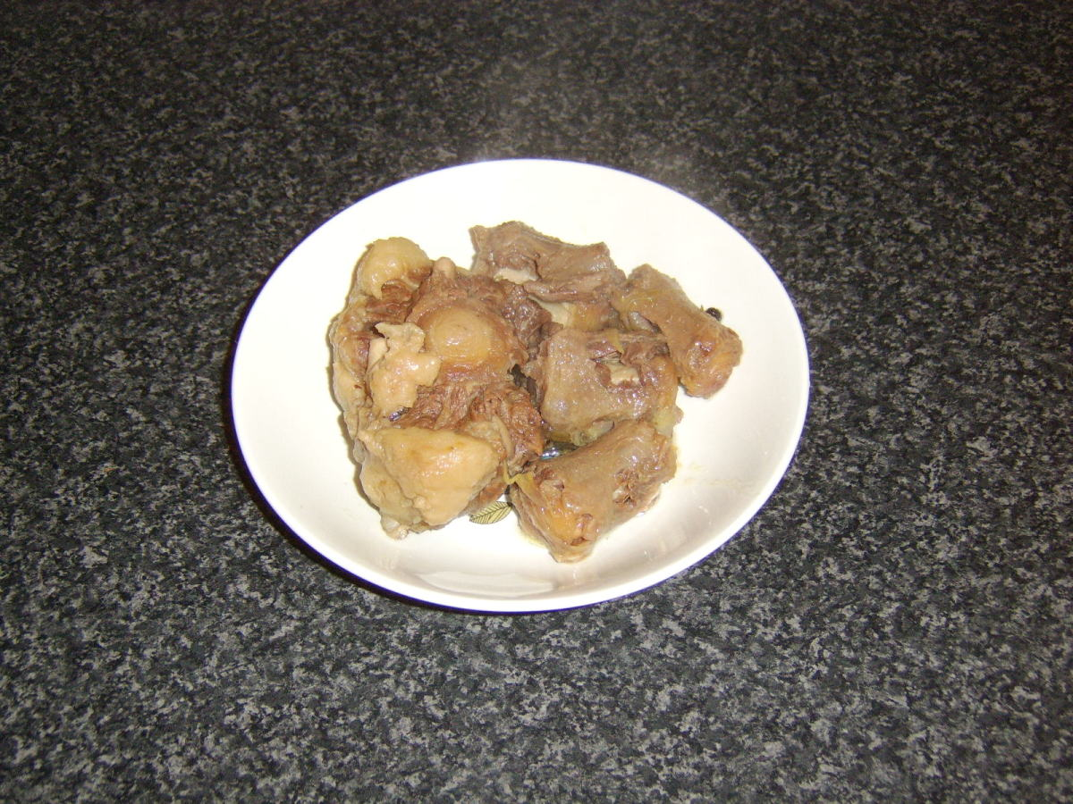 Oxtail pieces are removed from pot
