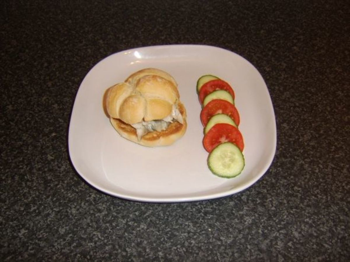 Poached mackerel bread roll is served