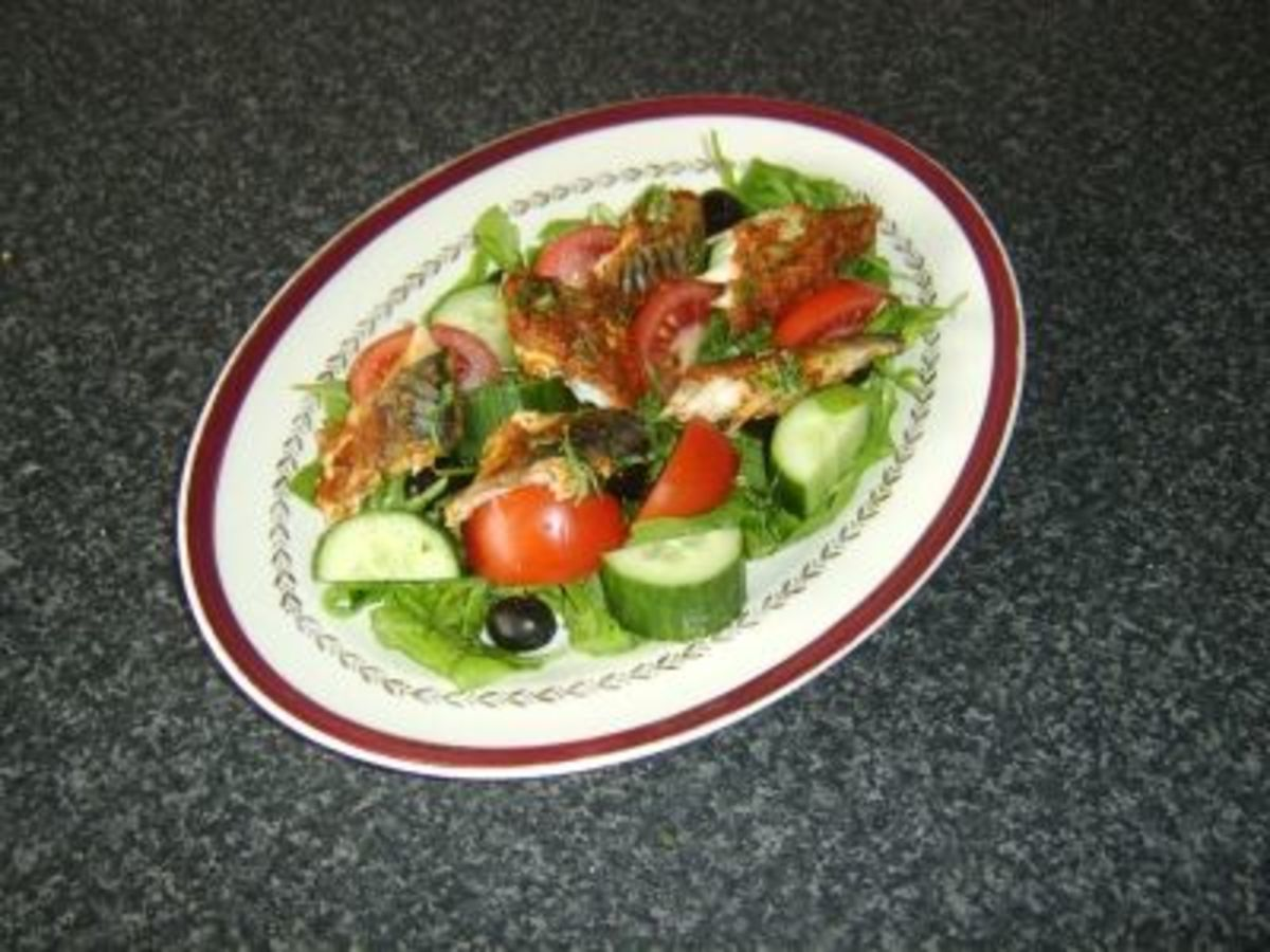 Mackerel is coated in red pesto sauce before being baked and served on a simple salad bed