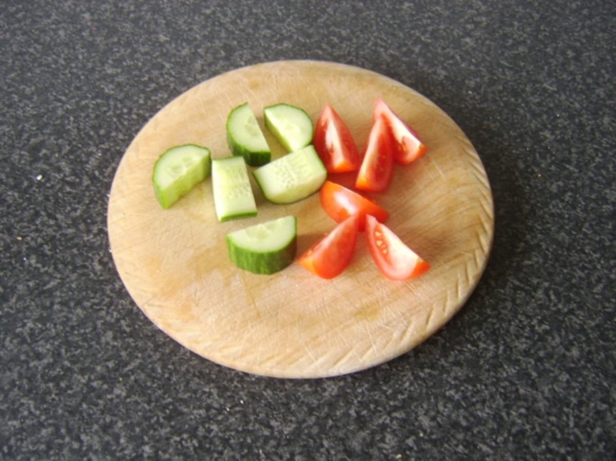 Chopping cucumber and tomato for salad