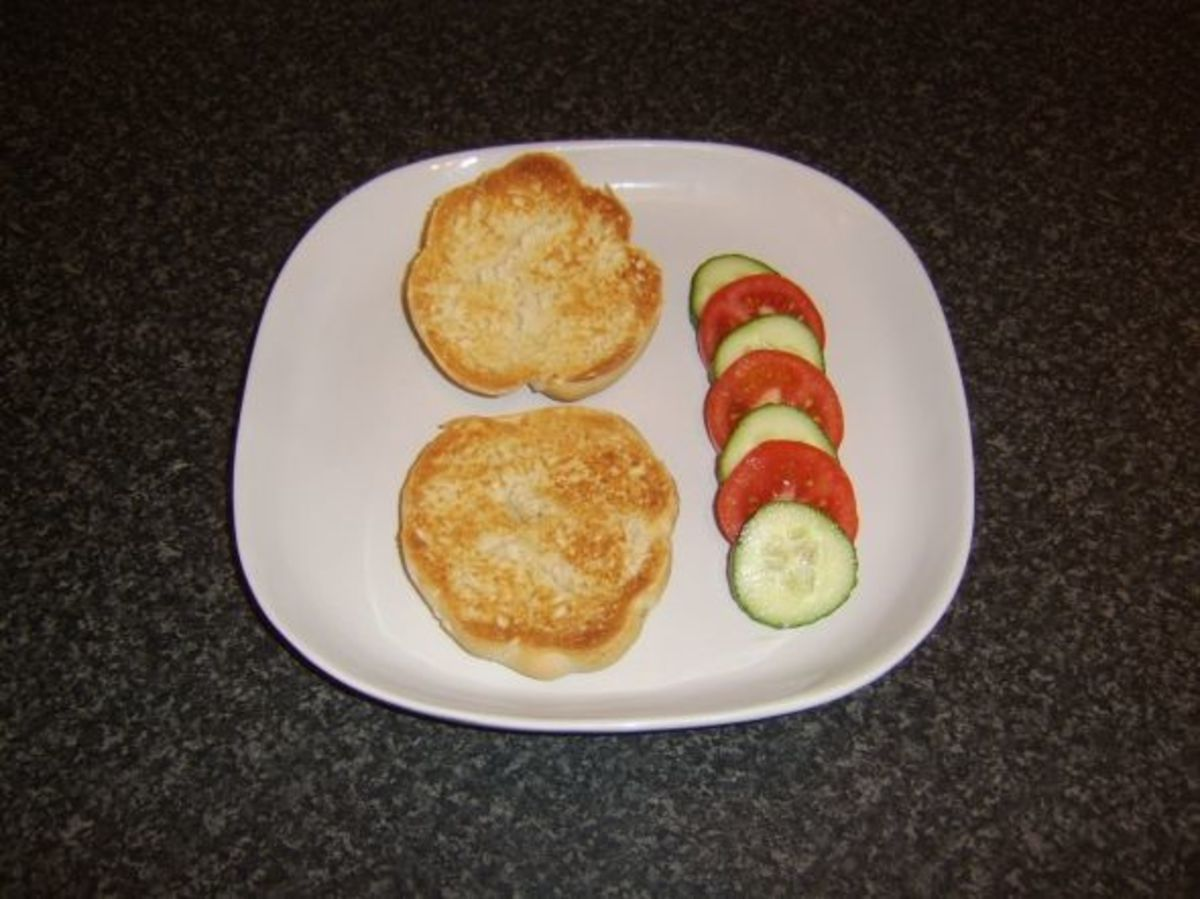 Toasted bread roll and simple salad garnish