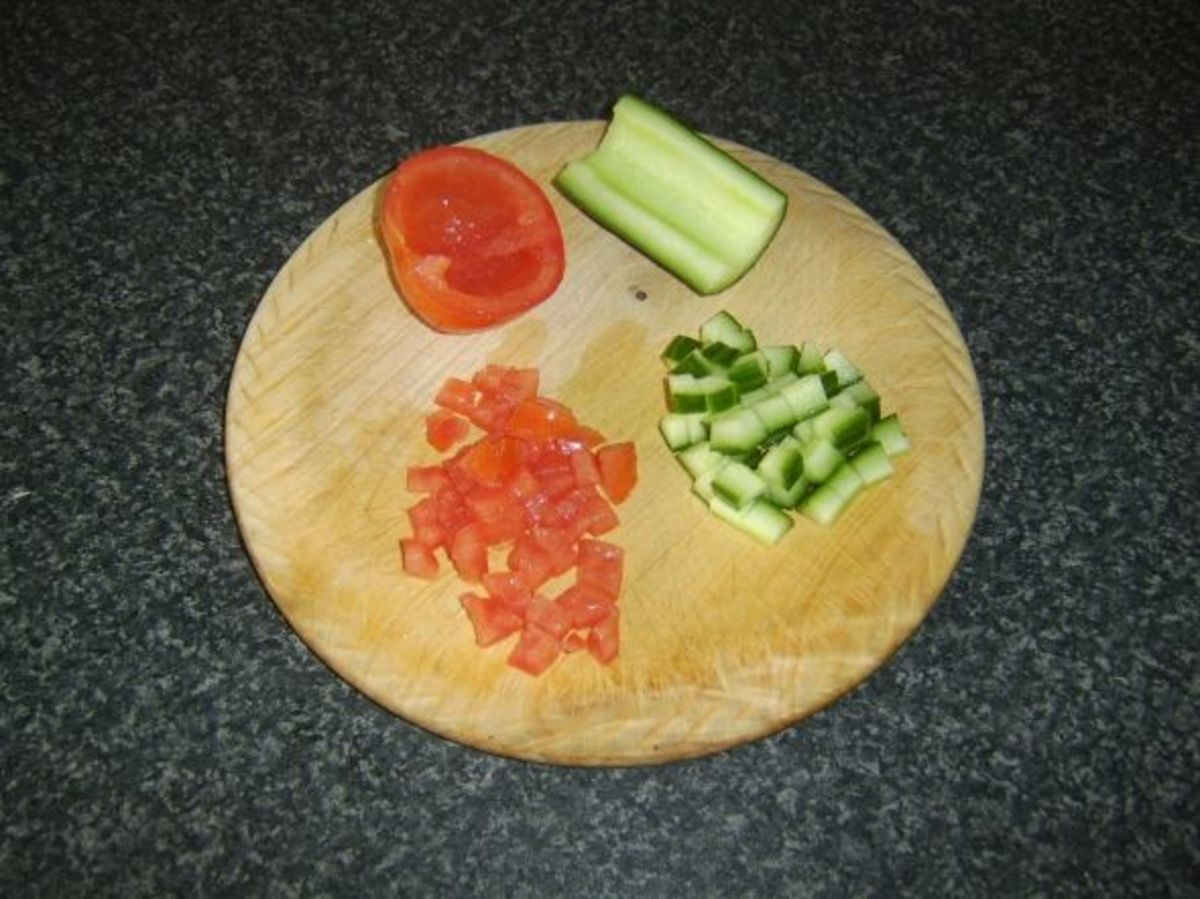 Preparing the tomato and cucumber for salsa