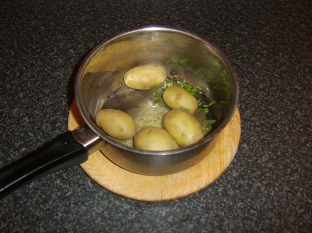 Potatoes are swirled in butter and mint