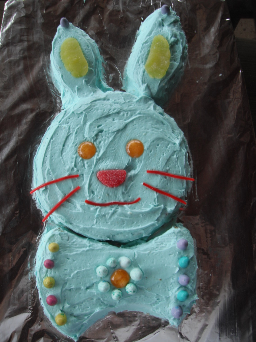 "The year we had a blue cake was the year the kids made it all on their own, without my help. They used butterscotch discs for the eyes and ""fruit"" slices for the nose and ears."