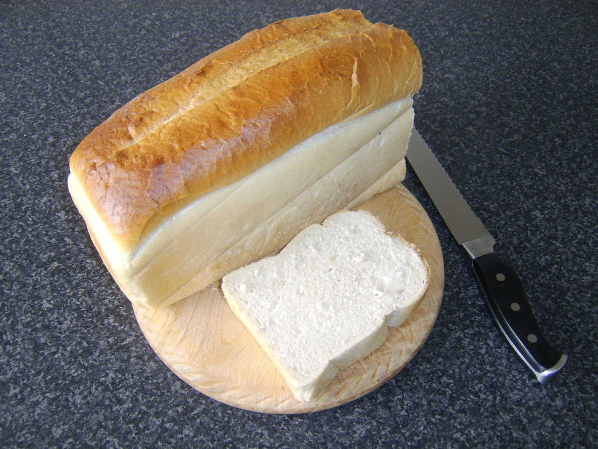 a loaf of bread with one slice cut