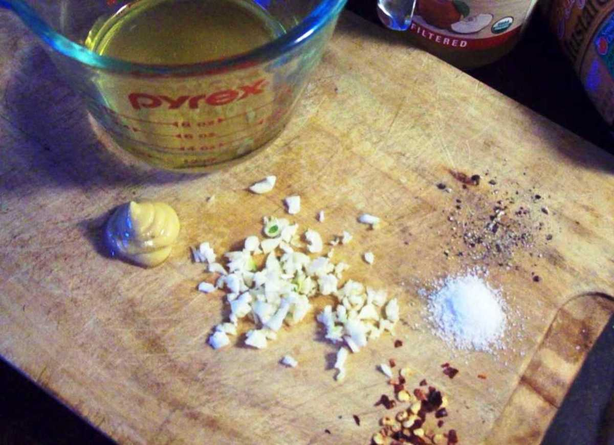 The vinaigrette is really simple: vinegar, olive oil, minced garlic, mustard, peppercorns and salt are all you need.