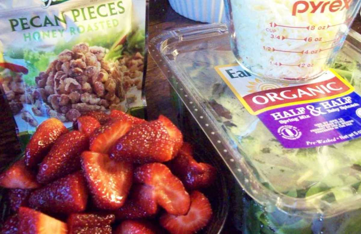 Strawberries, spring mix baby greens, pecans and a little bit of mozzarella make up this simple, yet delicious salad.