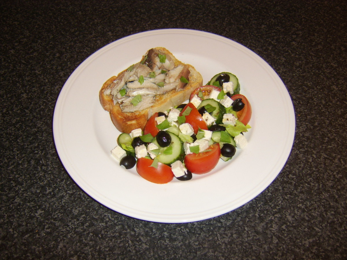Herring is poached and cooled before the flesh is picked from the bones and it is served on a slice of bruschetta with an accompanying Greek style salad