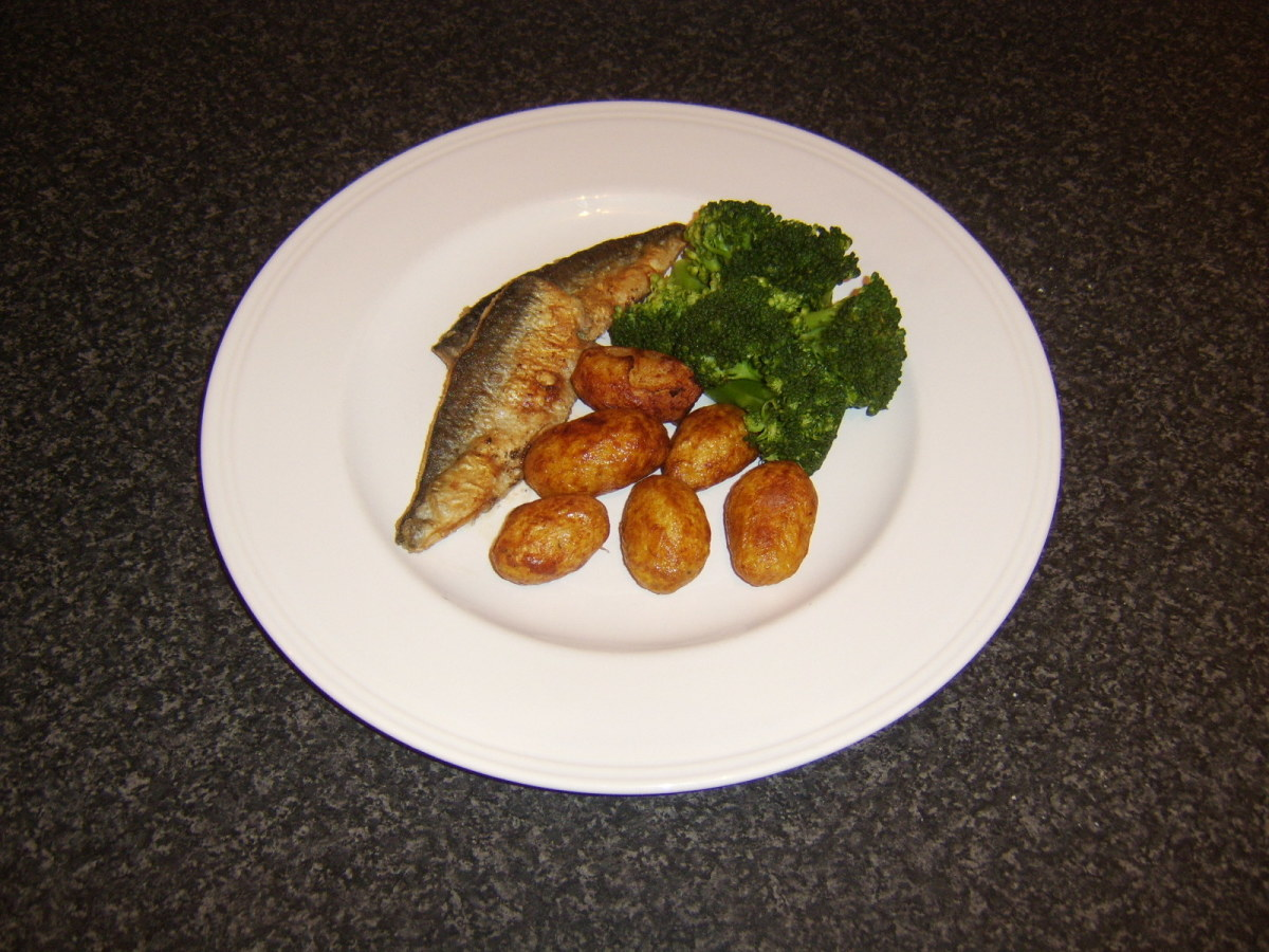Herring loin fillets are floured and shallow fried before being served with pan roasted potatoes and broccoli