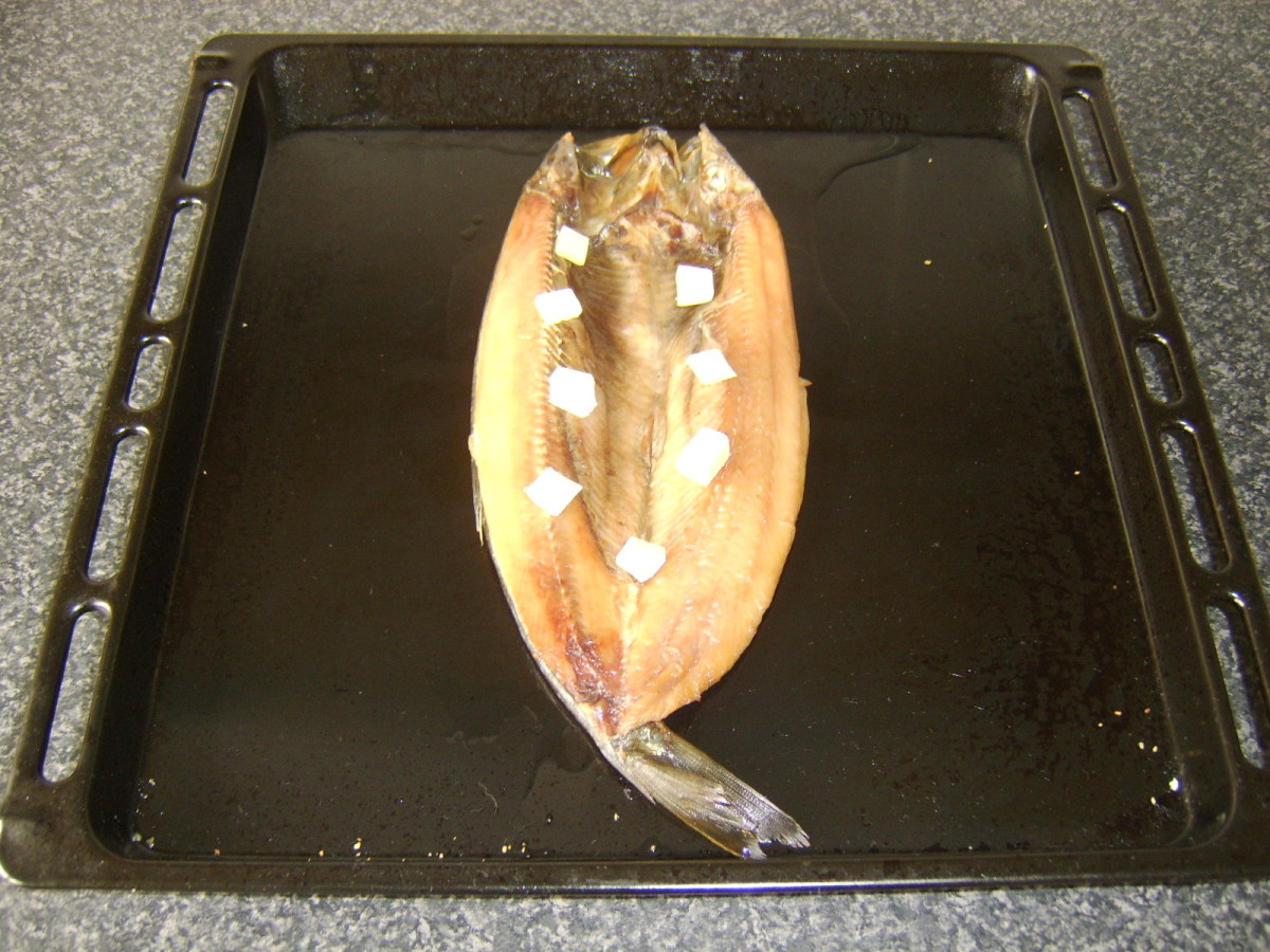 A little butter is added to the kipper before it is grilled