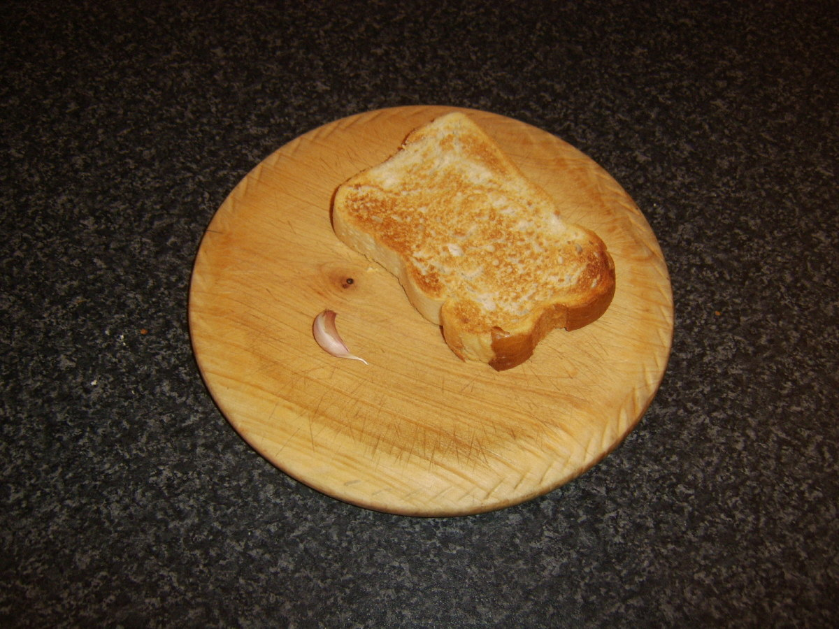 Hot toast is firstly rubbed with garlic