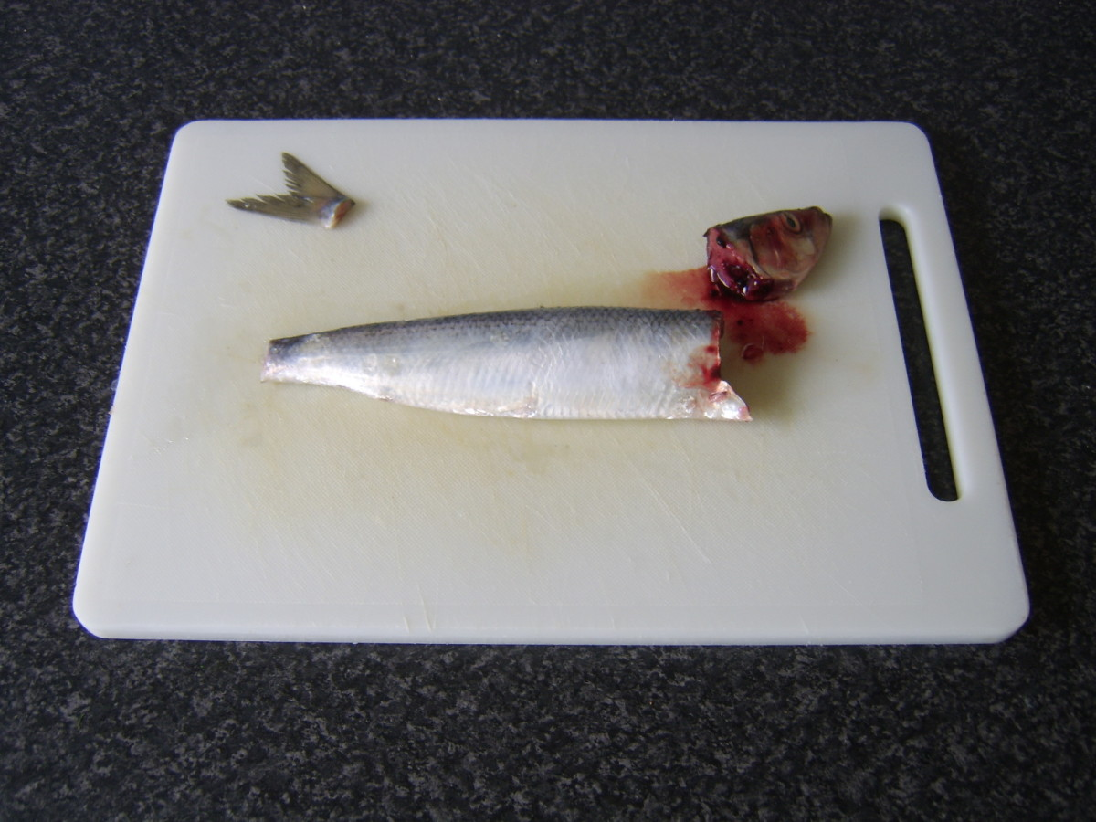 Head and tail are removed from the herring