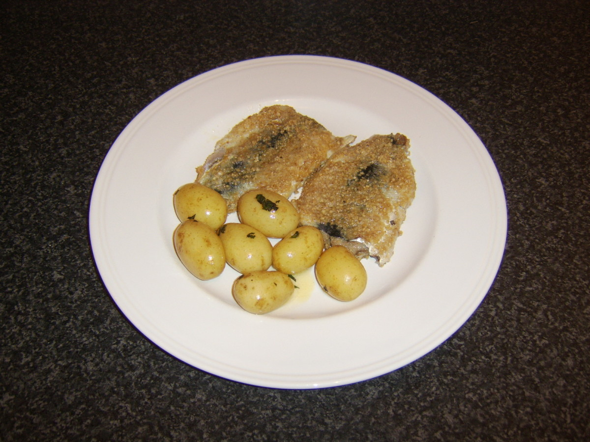 Fresh herring fillets are coated in oatmeal and gently shallow fried before being served with boiled, baby new potatoes coated in butter and fresh garden mint