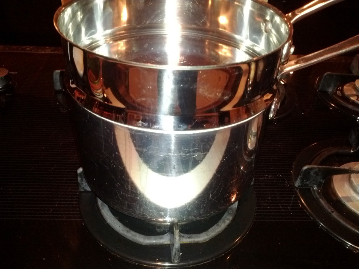 A double boiler has a pot on the bottom with the boiling water and a pot on top to hold the ingredients.  The point of the double boiler is to avoid direct heat.