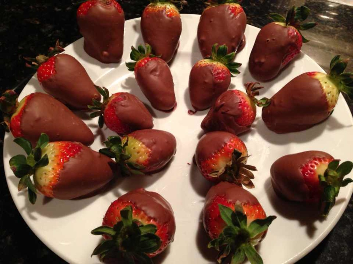 Chocolate strawberries arranged in a spiral on a plate for presentation