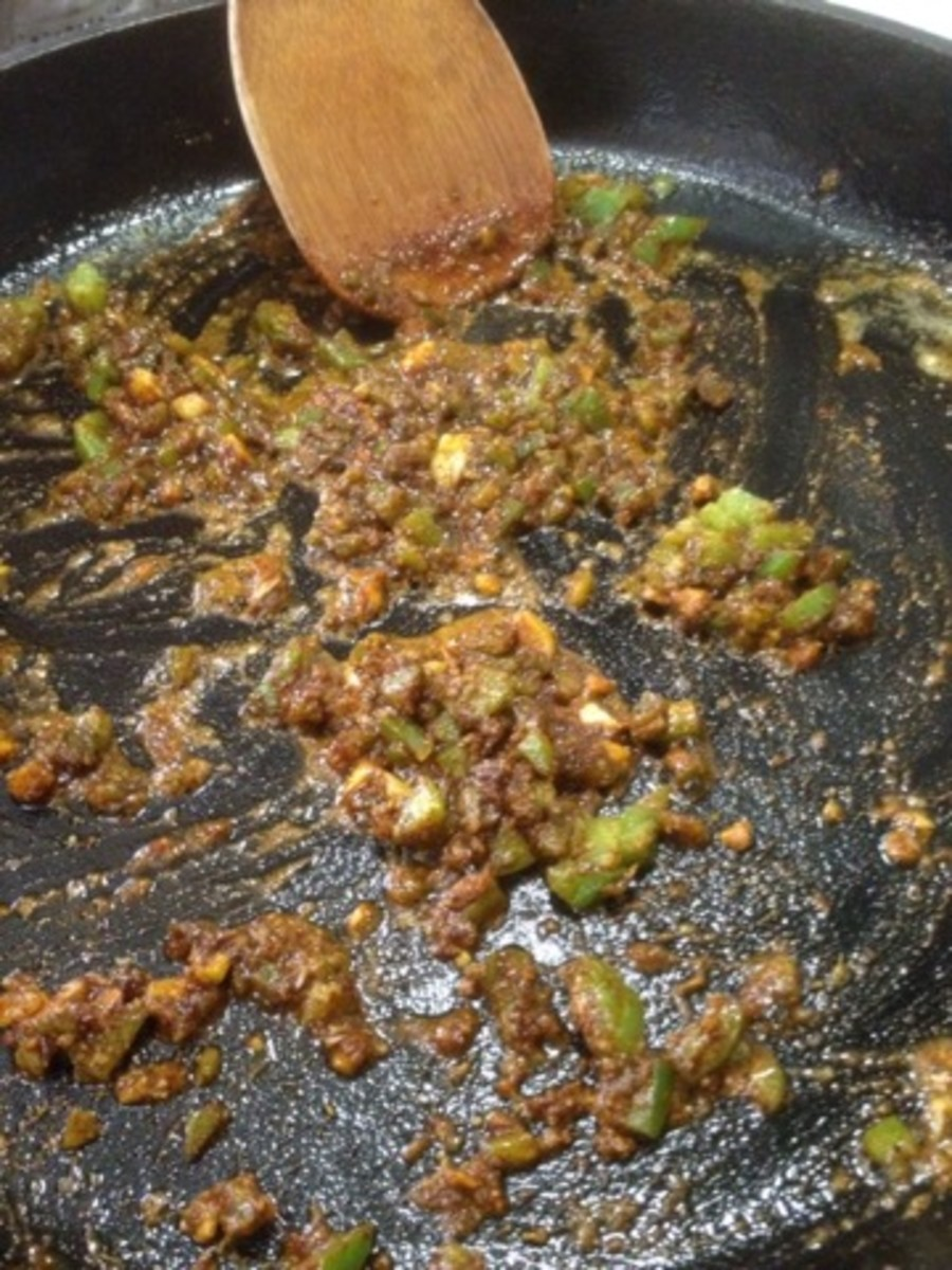 Mix your spices with the sauteed garlic and jalapenos.