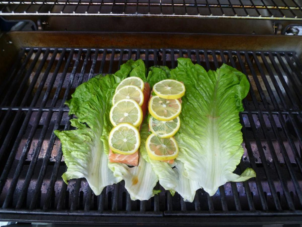 Now, place the salmon fillets right on top of the lettuce.