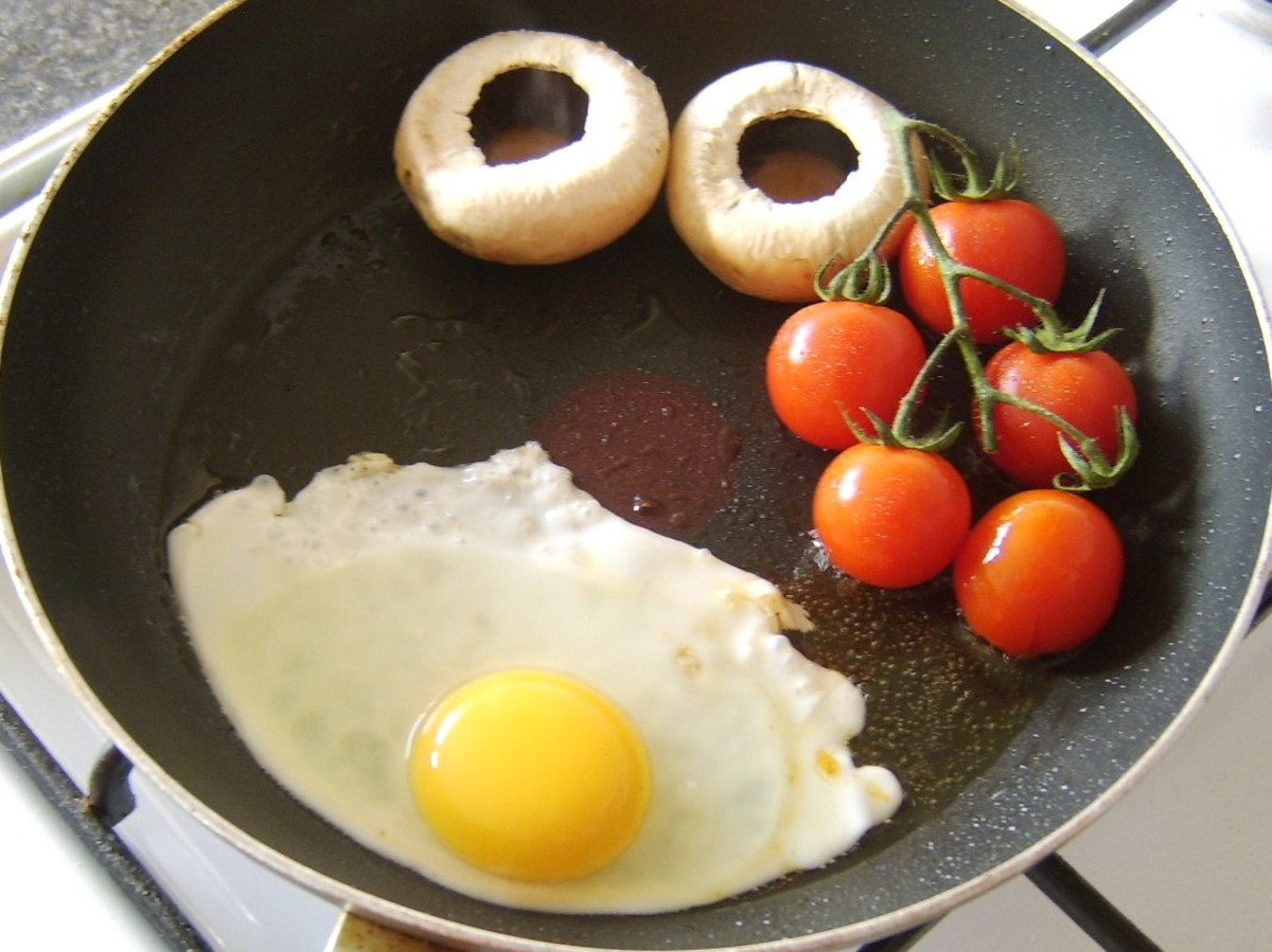 Egg is fried with the tomatoes and mushrooms