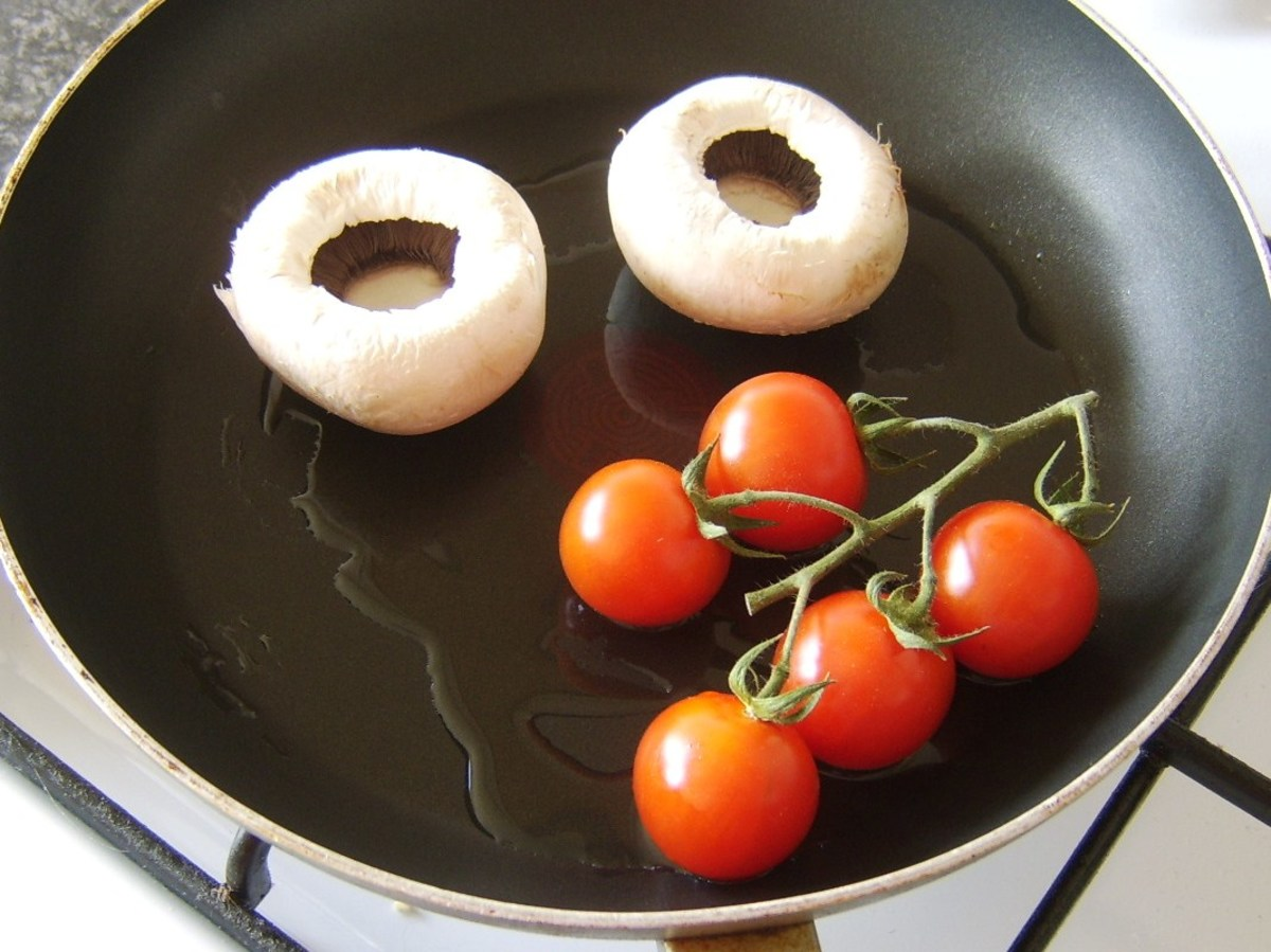 The tomatoes and mushrooms are added to a separate pan.