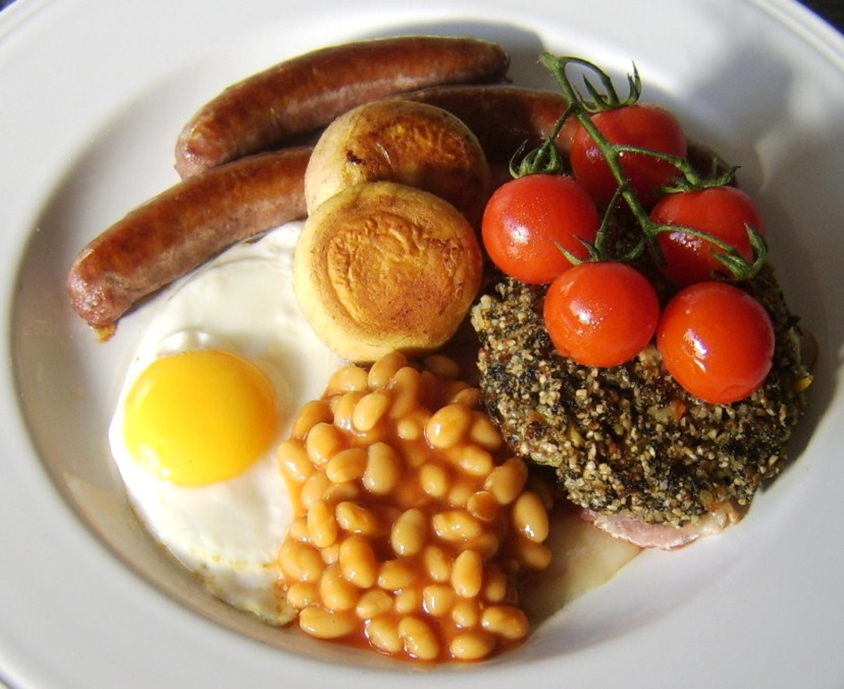 The baked beans are spooned on to the plate, the mushrooms are added and this full Welsh breakfast is ready for the table.